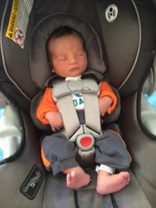 Infant properly secured in car seat
